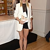 At the Beverly Hills signing of her book It's All Good, Gwyneth Paltrow showed off her toned legs in a black sheer ALC top that she paired with black shorts. She topped it off with a crisp white boyfriend blazer, black and gold sandals, and a chunky gold bracelet.