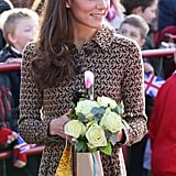 Kate Middleton wore a brown Orla Kiely dress.