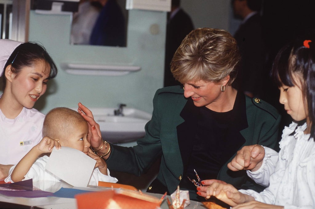 Diana shared a tender moment with a young boy while visiting a children's hospital in Japan in November 1990.