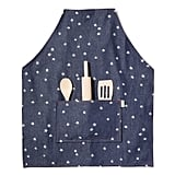 Kids love getting involved in the cooking, but they can cause quite a mess. Now they can get in on the action while looking cute and staying clean with this hand-silkscreened Kids' Apron ($60).