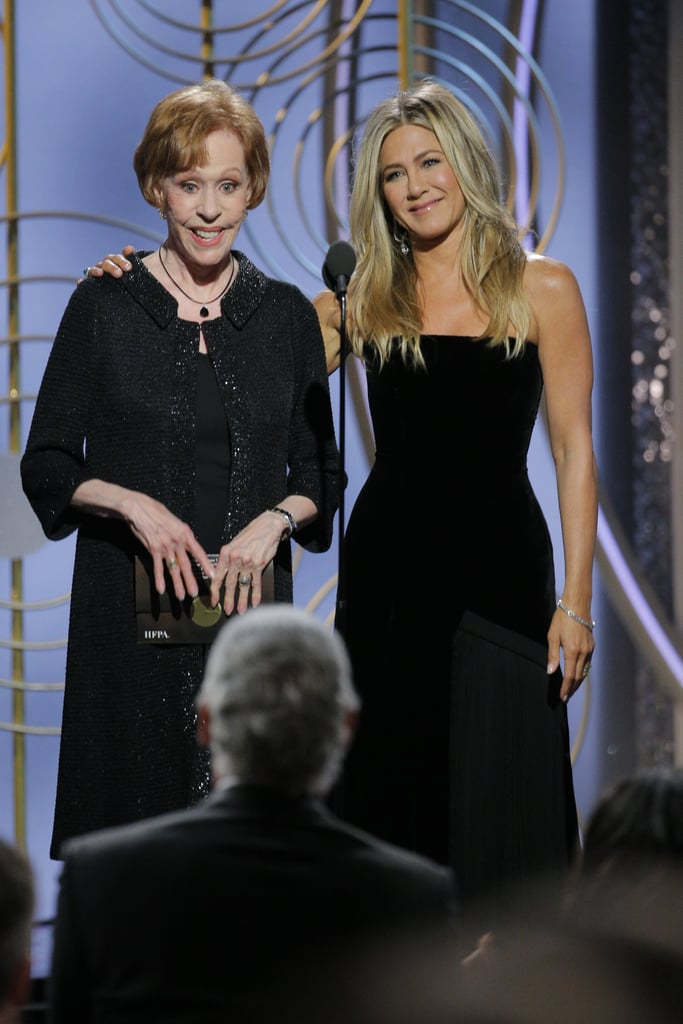 It was reported last week that Jennifer Aniston and Angelina Jolie would, for the first time in over a decade, be in the same place at the same time — and on Sunday night, the two actresses were both in attendance at the Golden Globes. While Jen skipped the red carpet — instead popping up on stage to present the award for best actress in a TV musical or comedy with Carol Burnett — Angelina arrived with her 14-year-old son Pax Jolie-Pitt, who looked dapper in a black suit.  Angelina and Jen have a public history that revolves around their mutual ex-husband Brad Pitt, and while it's entirely unlikely that the two came face to face during Sunday night's show, they both made sure to show their support for the Time's Up movement by wearing black dresses to the event. As for Brad? He stepped out for Sean Penn's annual Haiti relief gala on Saturday night and bid $120,000 to watch an episode of Game of Thrones with one of its stars, Emilia Clarke. Keep reading to see photos of Jen and Angelina at the Golden Globes.