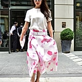 Wearing a pink printed midi skirt from her own collection in June 2015.