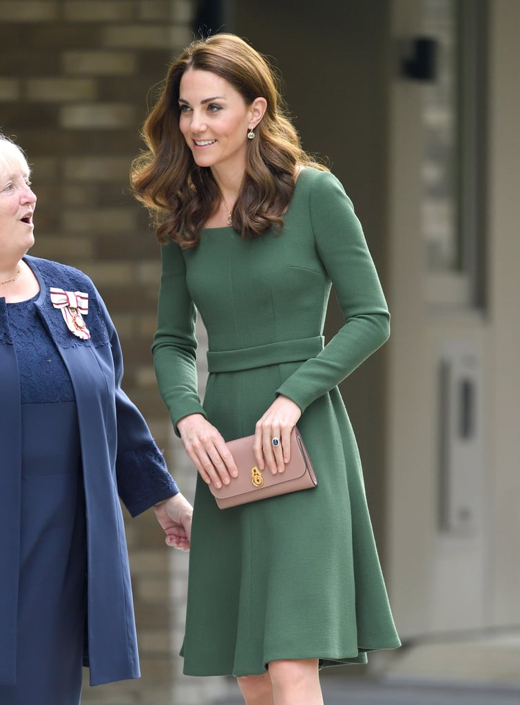 Kate Middleton stepped out for her first royal engagement of the new month on Wednesday, when she opened the new Anna Freud National Centre for Children and Families in London. For the occasion, the duchess turned to one of her favorite designers, Emilia Wickstead, opting for a dark green long-sleeved dress with a flippy hem and a built-in belt. It may be a familiar style for the duchess, as it's got a lot in common with a chic Beulah London dress she wore in February, but it looks like this is a brand new addition to her wardrobe.       Related:                                                                                                           Kate Middleton Adds Another Coat to Her Collection as She Steps Out With Prince Harry               Rather than matching the dress with accessories, Kate added a springlike touch by finishing her look with contrasting beige shoes and a clutch. The suede pumps were by Gianvito Rossi, while the clutch was a Mulberry Amberley. The duchess has worn this combo before, notably last November when she added them to a royal blue Jenny Packham dress. This time around, she finished the ensemble with a pair of drop earrings from one of her most frequently worn jewelry designers, Kiki McDonough. Keep reading to see the look from all angles ahead.