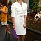 Cameron Diaz looks lively  in all white with a splash of colour in her purple purse.