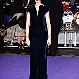 Eva Green was head to toe Tom Ford in a floor-length navy velvet dress with crocodile stamp gold plated cuffs and open toe sandals.