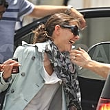 Katie Gives Tom a Birthday Kiss Then Heads to Paris For an Armani Show