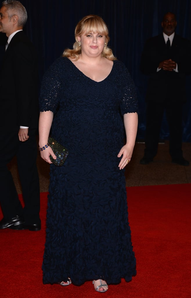 Rebel Wilson joined the festivities in a lacy, V-neck gown, which she complemented with an embellished clutch, jeweled House of Lavande bracelet, and metallic heels.