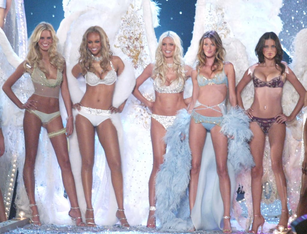 Karolina Kurkova, Tyra Banks, Heidi Klum, Gisele Bundchen, and Adriana Lima stood strong during the 2003 runway finale.