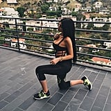 She Even Rocks a Strappy Silhouette With Workout Pants