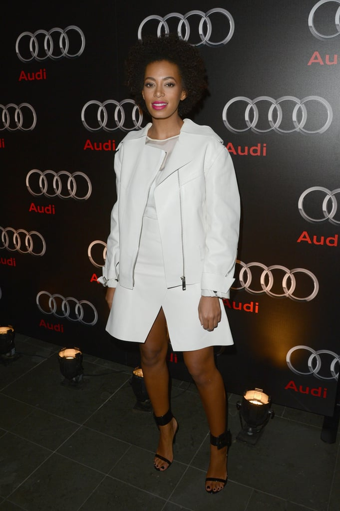 Solange Knowles hit up the Audi Super Bowl party in a minimalist-cool white look, which she then contrasted with a bright lip and black sandals.