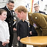 Prince Harry leaned in to chat with the 6-year-old boy who gave him a drawing.