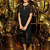 Alexa Chung with the Small Bryn in Black Shiny Grain Leather.