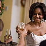 The Obamas raised their glasses during a state dinner in El Salvador.