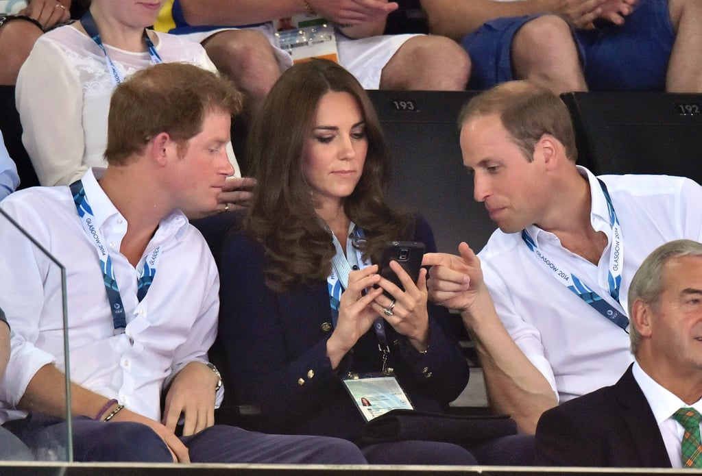 Kate showed Harry and William something on her phone during Monday's games.