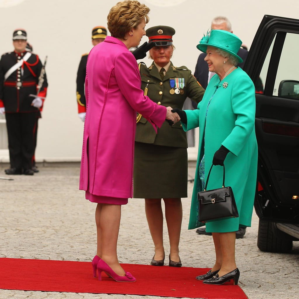 Irish President Mary McAleese, the country's second — and consecutive — female president, greets Queen Elizabeth in Dublin today. The queen is the first UK monarch to visit Ireland since 1911, following the country's bitter war for independence. Security is tight for the historic visit; police have already subverted a planned bomb attack and downtown Dublin is virtually a car-free zone. See more photos of the queen sporting her Irish green, as well as the protests, now.