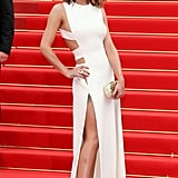 In Cannes for the 2010 Film Festival, Cheryl flashed some flesh in a white Versace gown.