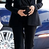 ‎Meghan Markle Carrying a Stella McCartney Shaggy Deer Faux Leather Crossbody Bag in Black