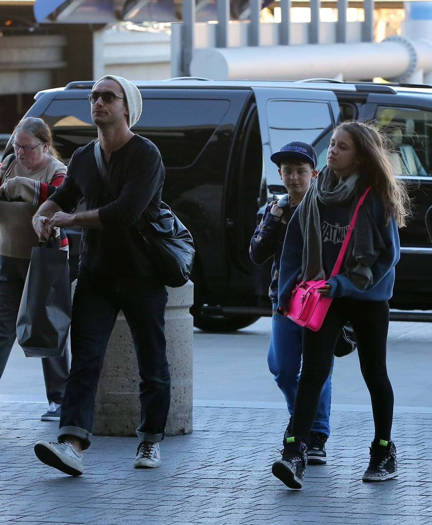 Jude Law's daughter Iris wore a pink bag.