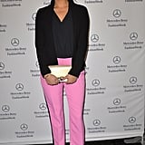 Shay Mitchell offset a bright pair of tuxedo-pink trousers with casual black separates at the Diane von Furstenberg Fall '13 show.
