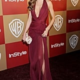 At the InStyle and Warner Bros. Golden Globes party, Miranda Kerr married bombshell curves with timeless elegance in a plunging Zuhair Murad gown and Ferragamo accessories — plus strappy sandals and a satin clutch.