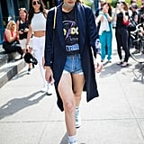 Grab your favorite band t-shirt and tuck it into your denim shorts for Gigi Hadid's look.