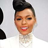 This off-center pompadour and red lipstick combination has become Janelle Monáe's signature style.