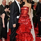 Amal confidently pulled off a fiery red Maison Margiela gown by John Galliano at the 2015 Met Gala.