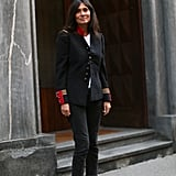 Emmanuelle Alt practically personified effortless chic in her lace booties and military coat.