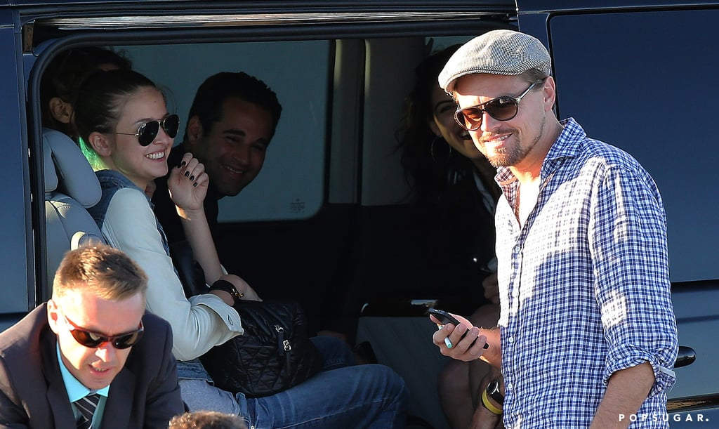 Leonardo DiCaprio smiled while chatting with a model.