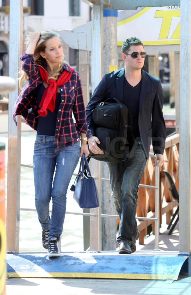 Michael Bublé and Luisana Lopilato continued their honeymoon tour of Italy this afternoon. They hopped on a train to Milan after spending the last few days in Venice, where they enjoyed a gondola ride and shared PDA. Michael and Luisana were married earlier this month in two different ceremonies in her native Argentina, and they then headed off on their couple's getaway. The celebrations apparently aren't over, though, since the duo plan to throw a large reception for friends and family in Michael's hometown of Vancouver. The newlyweds will have a few weeks to enjoy their new committed status before Michael returns to his tour in June.