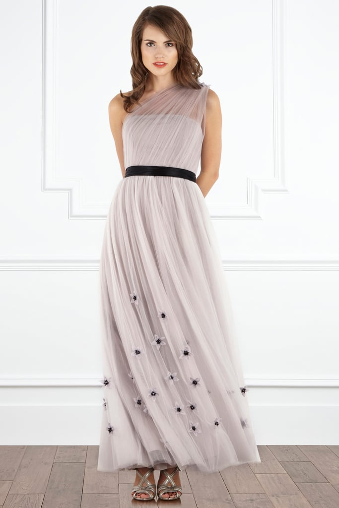 We couldn't resist this asymmetrical neckline dress for a more formal wedding occasion. Add metallic accents and you'll have one memorable ensemble. 