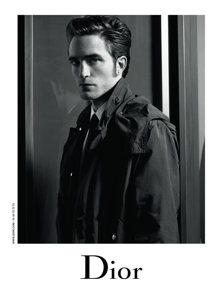 Robert Pattinson isn't new to the Dior family: he's appeared in ads for the fashion house's fragrances before and even showed off his acting skills in a sexy black-and-white video. But for the first time, the star is lending his good looks to Dior Homme's ready-to-wear collection, appearing in its Fall 2016 campaign, and we have to say — the guy looks good. Shot by Karl Lagerfeld himself, the two black-and-white photos show Robert looking more polished and intense than we've ever seen him before. In one pic he leans back, a single arm perched on the couch as he rocks a tartan shirt and sunglasses. In another, the actor is wearing a classic black trench, collared shirt, and tie. At this point, we don't know what we want more: to stare at him in these fashionable duds or to just rip them right off (and possibly keep the pieces for ourselves). Read on to see the ads ahead. Here's hoping there will be plenty more like these in the future.
