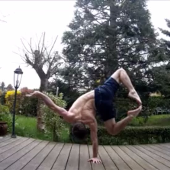 Man Doing One-Handed Handstands