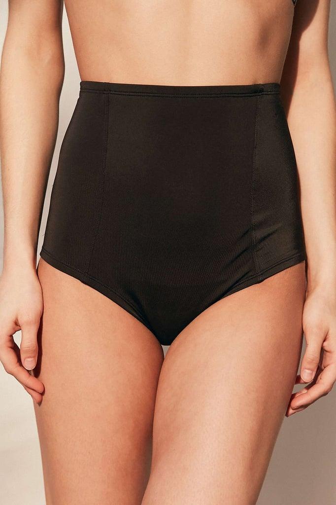 Wear a pair of high-waisted bikini bottoms ($42) under your sheer dress.