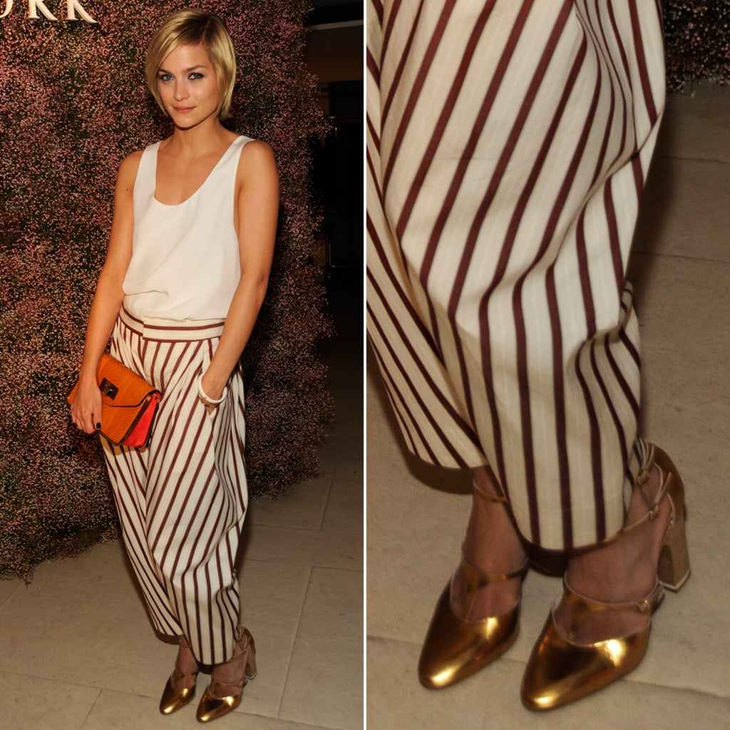 At a Barneys New York event in New York City, Leigh Lezark completed her striped trousers and orange clutch with shiny gold Mary Jane pumps.