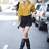 Style a Mustard Yellow Top With Shorts and Knee-High Boots