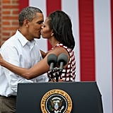 Barack and Michelle puckered up at a campaign rally in Dubuque, IA.