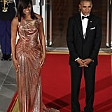Michelle in a stunning Versace gown at her final state dinner in 2016.