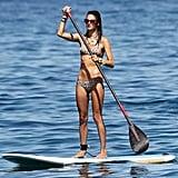 Alessandra Ambrosio paddleboarded in a bikini while in Hawaii in September 2011.