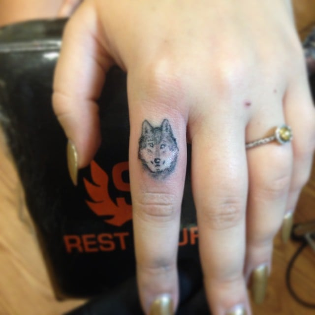 Tiny Wolf  98 Real Girl Tattoo Ideas For Your First Ink