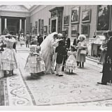 Princess Diana talked to the pageboy while Prince Charles and the Queen Mother looked on.