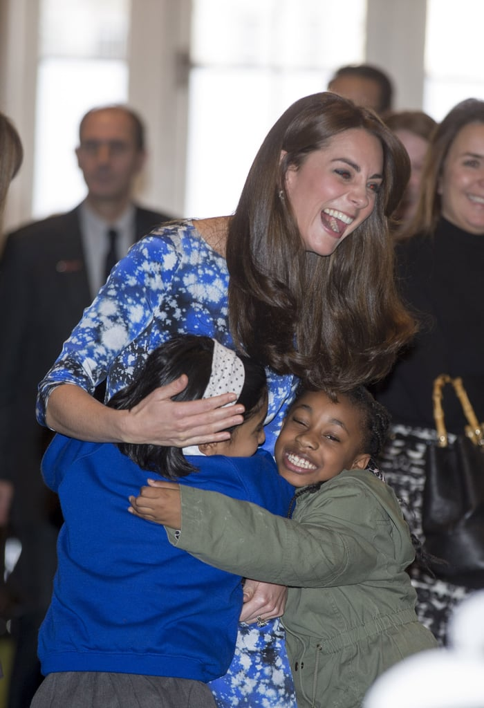 She was greeted with hugs by two little girls at a charity event in October 2015.