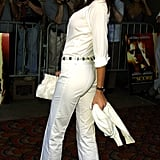 She styled white pants with sandals and a jewel-encrusted belt at a New York premiere in 2001.