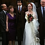 Christina Hendricks and Geoffrey Arend posed with family after their October 2009 nuptials in NYC. For the affair, the Mad Men actress went with a strapless Carolina Herrera gown.