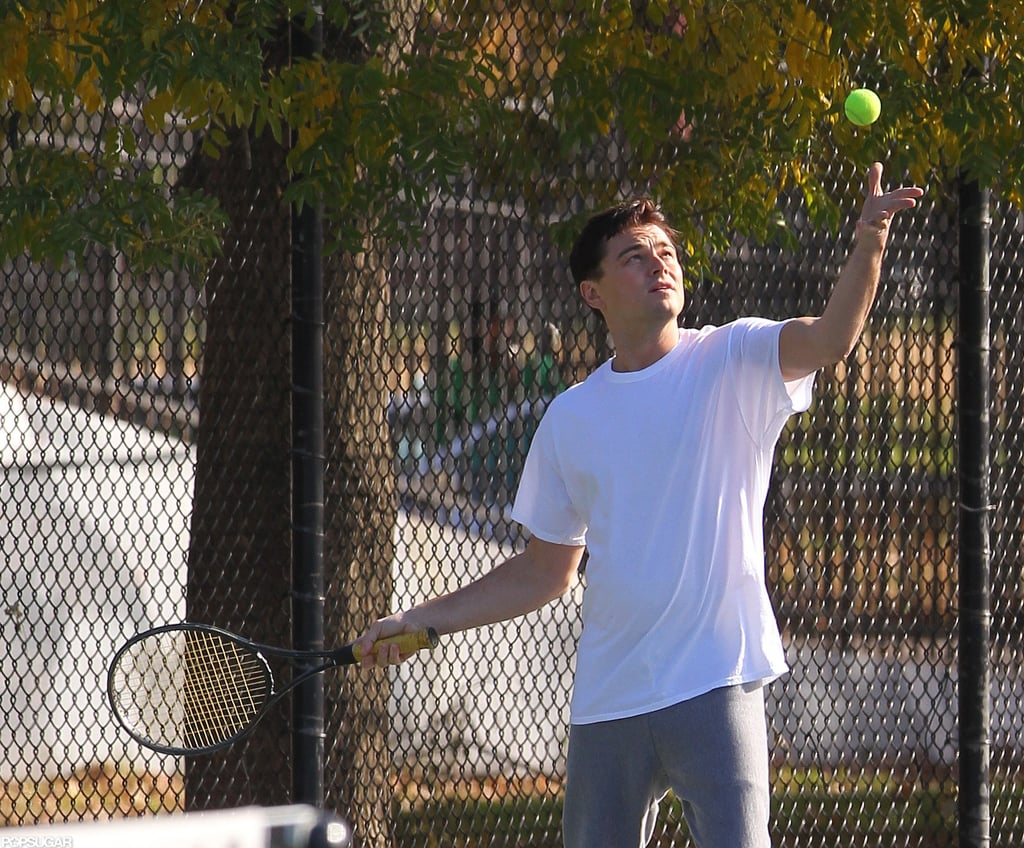 Leonardo DiCaprio tossed the ball up for a serve.