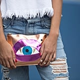 This Poppy Lissiman clutch doesn't feel too kitschy against grungy, distressed denim.