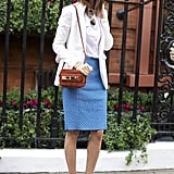 Hanneli Mustaparta showed off a chic Spring white blazer paired with a baby blue skirt and yellow sandals.  Photo courtesy of Street Peeper
