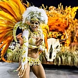 A member of Vila Isabel samba school performed during a parade in Rio de Janeiro, Brazil.