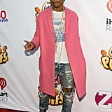 Leave it to Pharrell Williams to rock a pink coat. The musician attended the Jingle Ball in New York.
