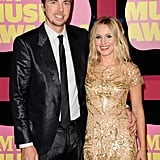 Kristen Bell posed with fiancé Dax Shepard at the CMT Music Awards.